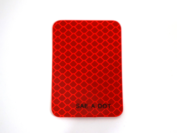 12369 REFLECTOR, RED ADHESIVE BACKED    2x3 inch